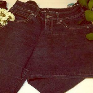 Dark denim flared jeans.